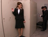 Horny Asian office babe, Haruka Sanada gives a nice handjob picture 3
