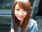 Hot teen, Akiho Yoshizawa gives a steaming blowjob in a car picture 12