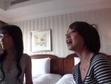 Two amazing milfs, Emiri Takayama, and her girlfriend share cock picture 11
