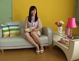 Horny Asian teen, Chihiro Nishikawa strips and masturbates on the couch picture 11