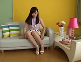 Horny Asian teen, Chihiro Nishikawa strips and masturbates on the couch picture 12