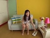 Horny Asian teen, Chihiro Nishikawa strips and masturbates on the couch picture 13