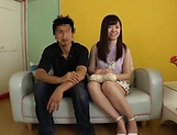 Horny Asian teen, Chihiro Nishikawa strips and masturbates on the couch