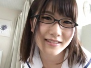 Schoolgirl with glasses gives a sensual striptease