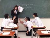 Sexy Asian teacher Yui Tatsumi masturbates in front of class picture 12