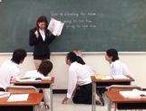 Sexy Asian teacher Yui Tatsumi masturbates in front of class picture 13