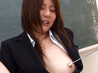 Enthralling Asian teacher, Yui Tatsumi fingers pussy in class