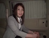 Hot Asian office babe gives head in a car picture 13