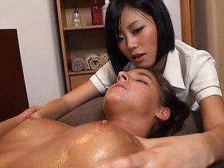 Horny Asian masseuse pleasures European babe