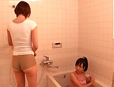 Horny lesbian babes Ryo Sena, and Rabu Saotome have fun in the bathroom picture 14