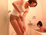 Horny lesbian babes Ryo Sena, and Rabu Saotome have fun in the bathroom