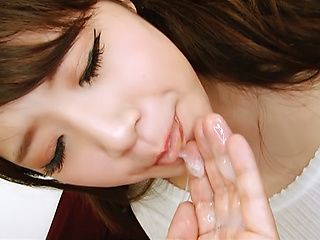 Gorgeous young Asian babe Erina Kahara gives a hot blowjob