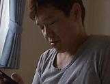 Horny babe Harura Mori gives a hot blowjob in the hallway