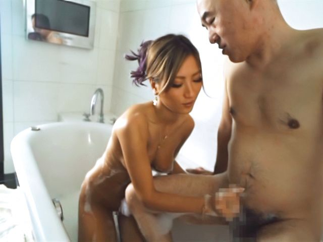 Adorable Aika Soggy licks erotically in a bathtub