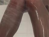 Asian Milf Reiko Sawamura in sexy pantyhose enjoys a soapy fuck picture 12