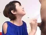 Hot Asian MILF Makoto Yuuki gives a sizzling handjob and blowjob picture 14