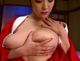 Horny Asian MILF, Minako Komukai, fucks herself with a big toy picture 10
