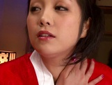 Horny Asian MILF, Minako Komukai, fucks herself with a big toy picture 1