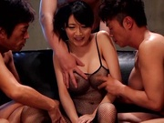 Busty MILF Miki Ichiki, in fishnets gets herself fucked by three guys