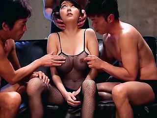 Busty MILF Miki Ichiki, in fishnets gets herself fucked by three guys