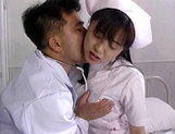 Sexy nurse Hitomi Kouya in stockings gets hardcore banging from doctor picture 13