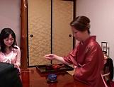 Horny Okazaki Hanae slides her fingers down picture 12