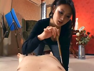 Playful Asian milf Risa Murakami sucks cock and gives a footjob on pov