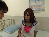 Hot Asian babe in school uniform gives a hot blowjob picture 1
