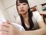 Appealing Japanese AV model seduces a cute bald guy gives a foot job picture 26