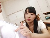 Appealing Japanese AV model seduces a cute bald guy gives a foot job picture 27