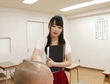 Appealing Japanese AV model seduces a cute bald guy gives a foot job picture 5