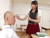 Appealing Japanese AV model seduces a cute bald guy gives a foot job