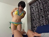 Eri Natsume, sexy Asian teen in a bikini gives hot blowjob