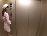 Hot elevator hostess Kaede Fuyutsuki gives head on the job picture 6
