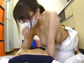 Hot nurse with glasses sucks and gives a tit fuck