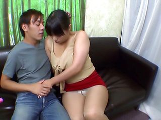 Japanese AV Model in a short skirt gives stellar blowjob