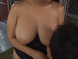 Japanese milf Haduki Naho begs for a steamy tit fuck picture 14