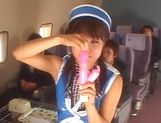 Hot Japanese stewardess has a nasty threesome picture 15