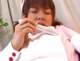 Horny JP nurse Tsumiki Shindo fucks her hairy pussy with a toy picture 12
