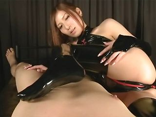 Yuna Shiina naughty Asian milf in latex enjoys giving footjob