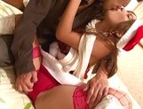 Busty Japanese cutie in a Santa's costume gets fucked doggie fashion picture 15