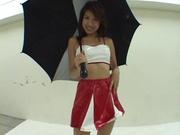 Hot Asian race queen, Risa Arisawa in a sexy dress sucks cock