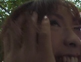 Naughty Asian babe, Minami Aikawa, in outdoor oral sex picture 15