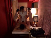 Lucky dude gets worked on by three hot masseurs