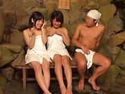 Charming beauties gets their tits exposed at a sauna