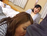 Japanese mature joins in a hot group sex session picture 15