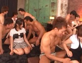Crazy Japanese milfs have sex with their boyfriends in a wild orgy picture 12