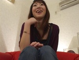 Arousing Asian babe bares pussy in hot solo acts