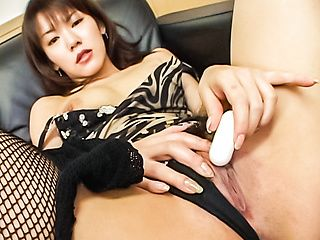 Sensual Japanese babe teases her pussy with toys in solo show