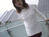 Mischievous Japnese teen, Riho Mishima, gives a blowjob in a toilet on pov picture 11